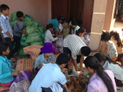 Youth packaging rice & foods for poor villagers